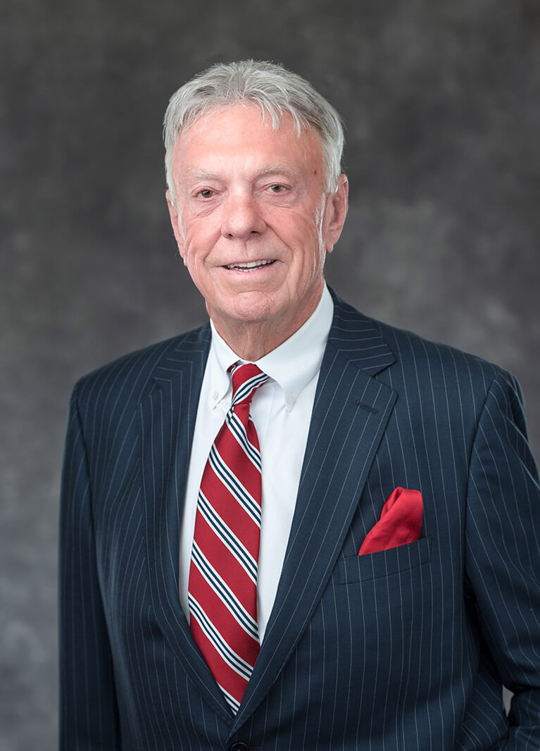 Val Eversgerd wearing a suit with a red and white tie photo