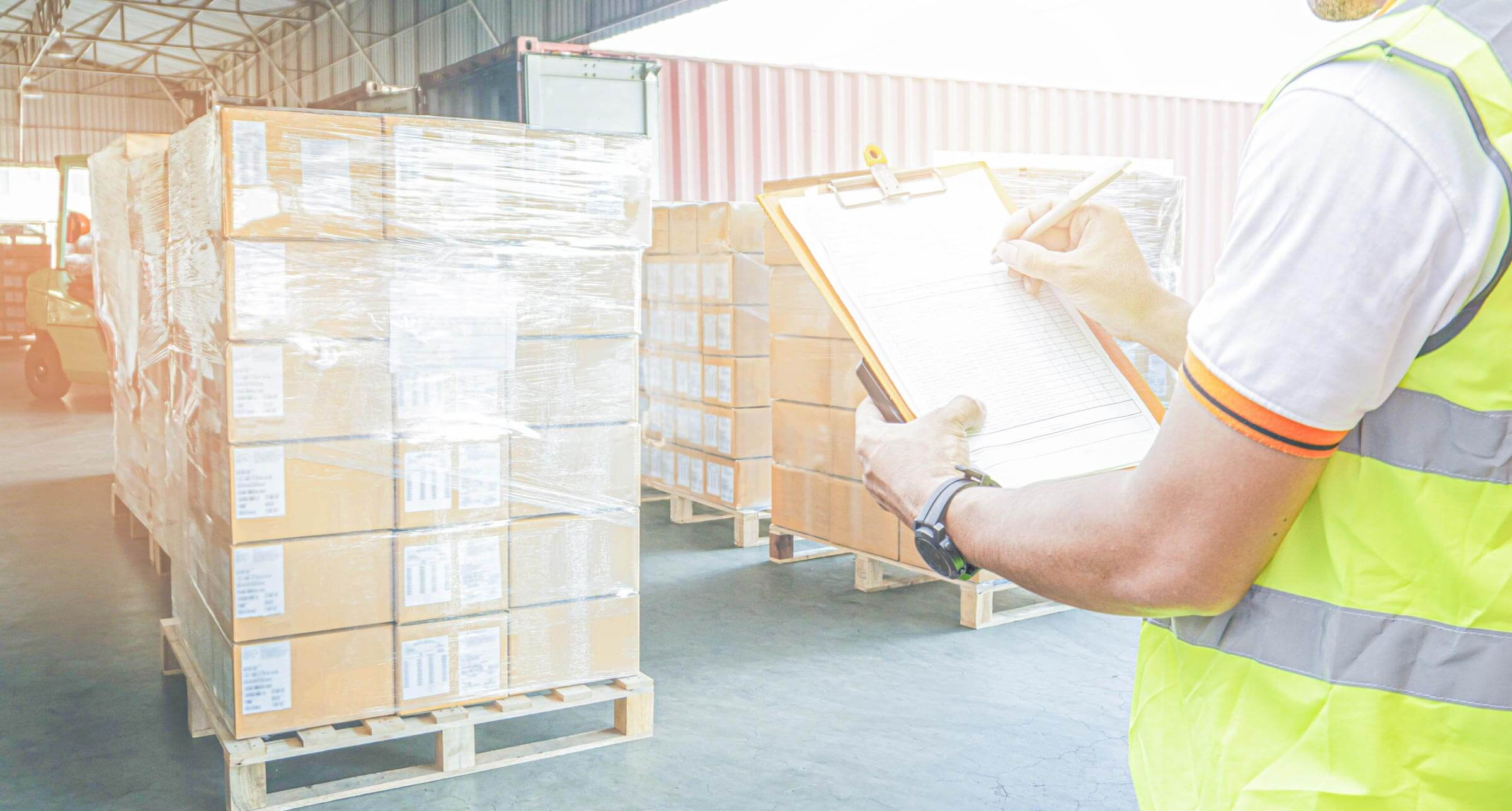 Man with clipboard in warehouse image