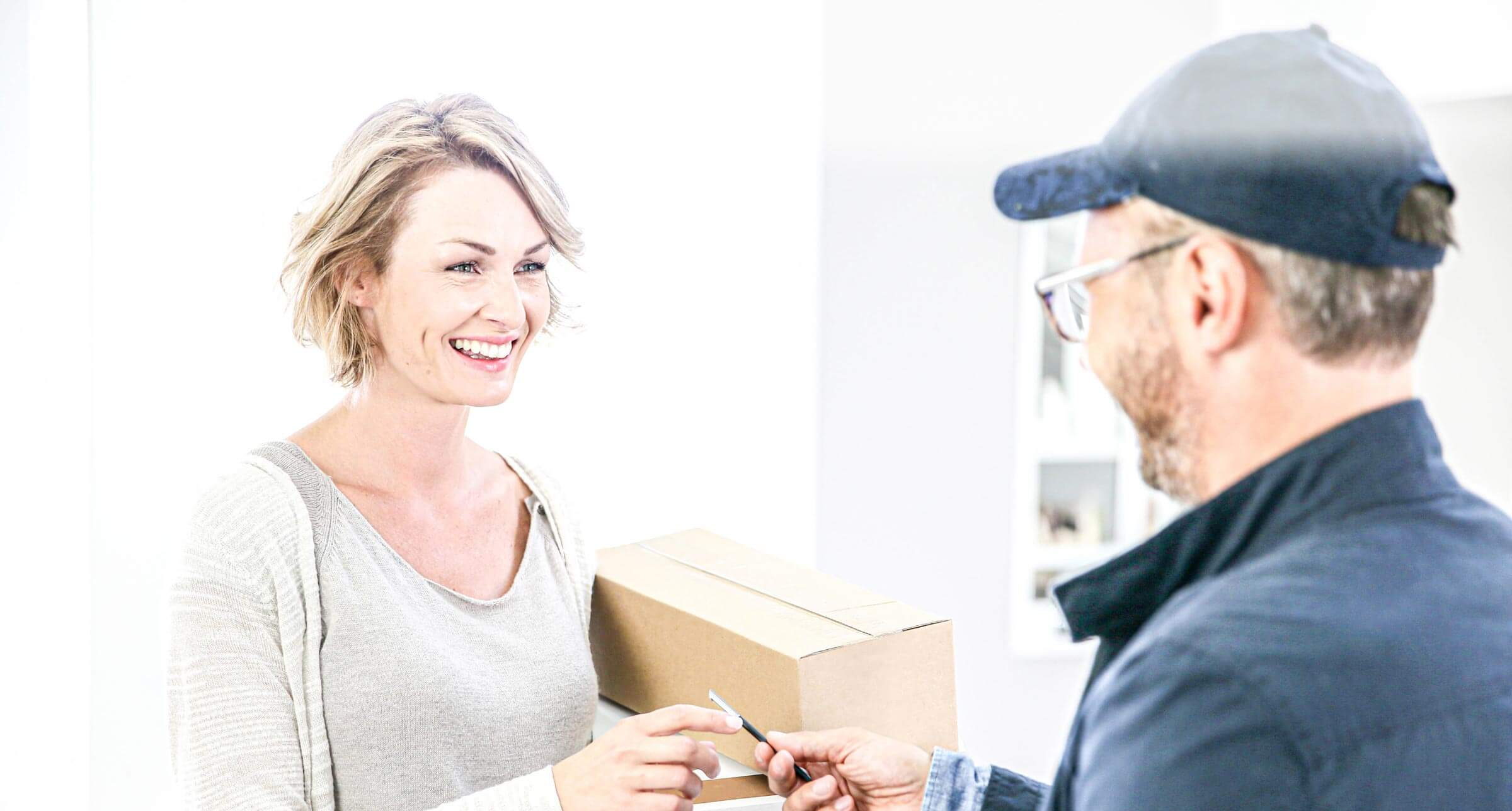 Man delivering woman parcel image