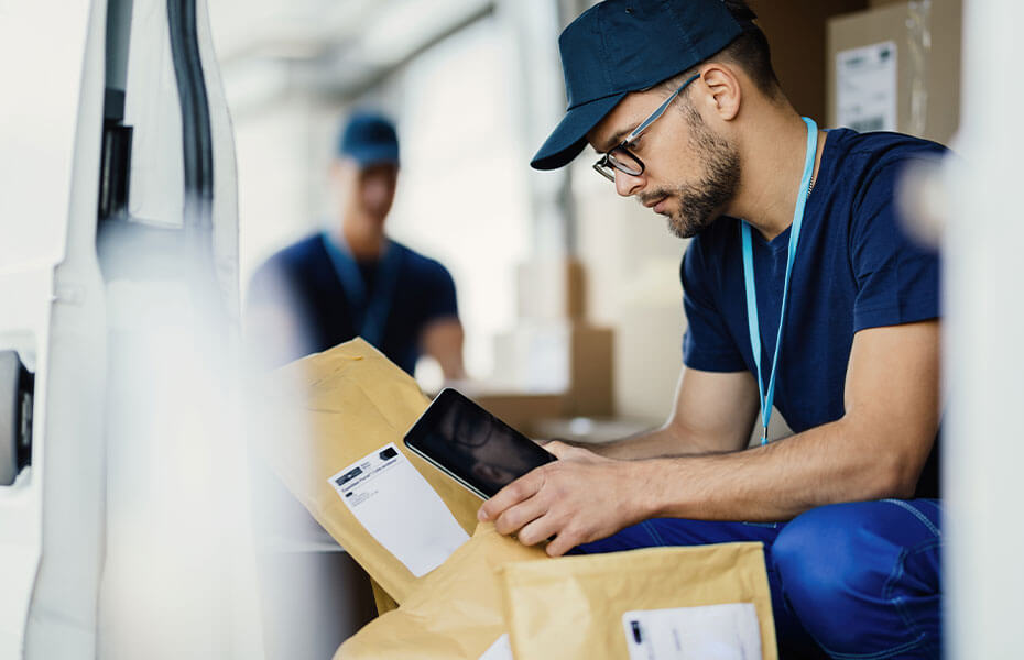 Man scanning packages before delivery image